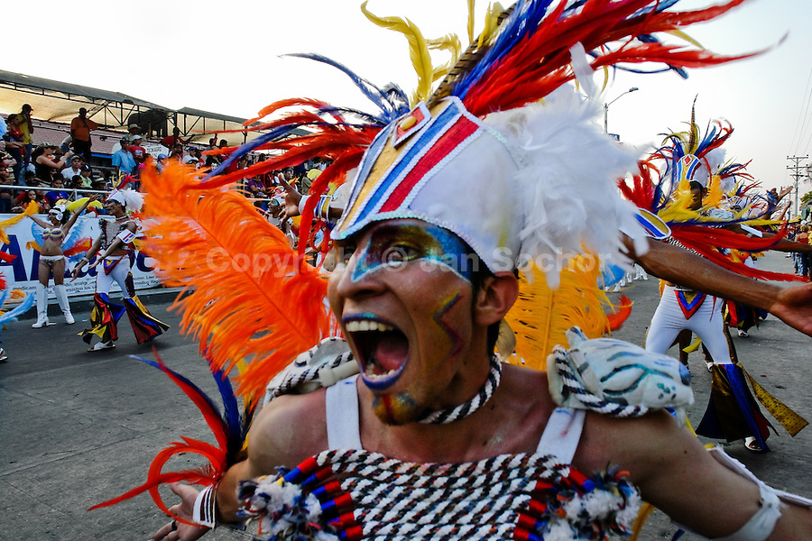 A Colombian boy dances a tribal dance during the Carnival in Barranquilla, Colombia, 25 February 2006. The Carnival of Barranquilla is a unique festivity which takes place every year during February or March on the Caribbean coast of Colombia. A colourful mixture of the ancient African tribal dances and the Spanish music influence - cumbia, porro, mapale, puya, congo among others - hit for five days nearly all central streets of Barranquilla. Those traditions kept for centuries by Black African slaves have had the great impact on Colombian culture and Colombian society. In November 2003 the Carnival of Barranquilla was proclaimed as the Masterpiece of the Oral and Intangible Heritage of Humanity by UNESCO.