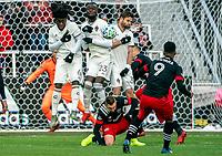 WASHINGTON, DC - FEBRUARY 29: Ola Kamara #9 of DC United blasts a free kick at Lalas Abubakar #6 , Kei Kamara #23, and Drew Moor #3 of the Colorado Rapids during a game between Colorado Rapids and D.C. United at Audi Field on February 29, 2020 in Washington, DC.