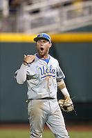 UCLA Bruins outfielder Eric Filia #4 celebrates during Game 4 of the 2013 Men's College World Series between the LSU Tigers and UCLA Bruins at TD Ameritrade Park on June 16, 2013 in Omaha, Nebraska. The Bruins defeated the Tigers 2-1. (Brace Hemmelgarn/Four Seam Images)