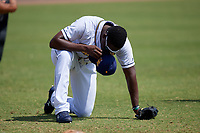 Montgomery Biscuits Jesus Sanchez (4) prays before a Southern League game against the Mobile BayBears on May 2, 2019 at Riverwalk Stadium in Montgomery, Alabama.  Mobile defeated Montgomery 3-1.  (Mike Janes/Four Seam Images)