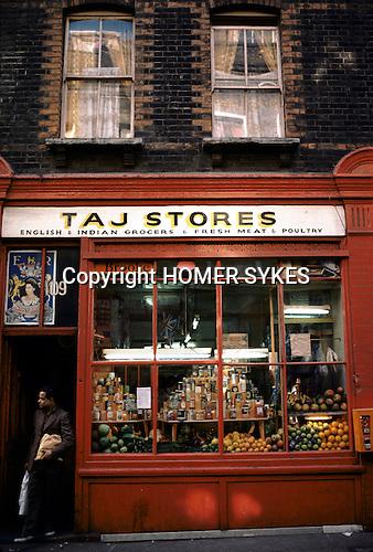 Silver Jubilee celebrations, London 1977.Uk Silver Jubilee poster hanging up in Indian shop window Brick Lane London. UK