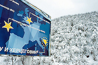 Bosnia and Herzegowina. Republika Serpska. Srebrenica. View on the forest and the hills during the winter season. A poster for Bosnia to be part of Europe. © 2005 Didier Ruef