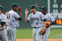 Second baseman Hunter Cole (19) of the Augusta GreenJackets, center, high-fives pitcher Raymundo Montero (45) after a game against the Greenville Drive on Sunday, April 12, 2015, at Fluor Field at the West End in Greenville, South Carolina. Augusta won, 2-1. (Tom Priddy/Four Seam Images)