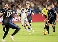 CARSON, CA - SEPTEMBER 21: Cristian Pavon #10 of the Los Angeles Galaxy crosses a ball during a game between Montreal Impact and Los Angeles Galaxy at Dignity Health Sports Park on September 21, 2019 in Carson, California.