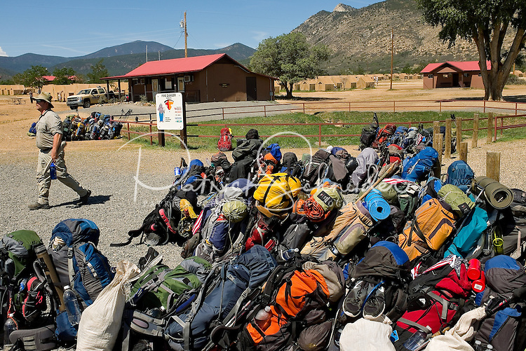 Photo story of Philmont Scout Ranch in Cimarron, New Mexico, taken during a Boy Scout Troop backpack trip in the summer of 2013. Photo is part of a comprehensive picture package which shows in-depth photography of a BSA Ventures crew on a trek. In this photo, rows of backcountry ready backpack await pick up and transport with their crews from Philmont Scout Ranch into the backcountry for the start of their trek.<br /> <br /> Photo by travel photograph: PatrickschneiderPhoto.com