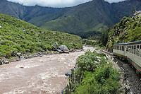 Peru.  Urubamba River Seen from Inca Rail Train en Route to Machu Picchu.