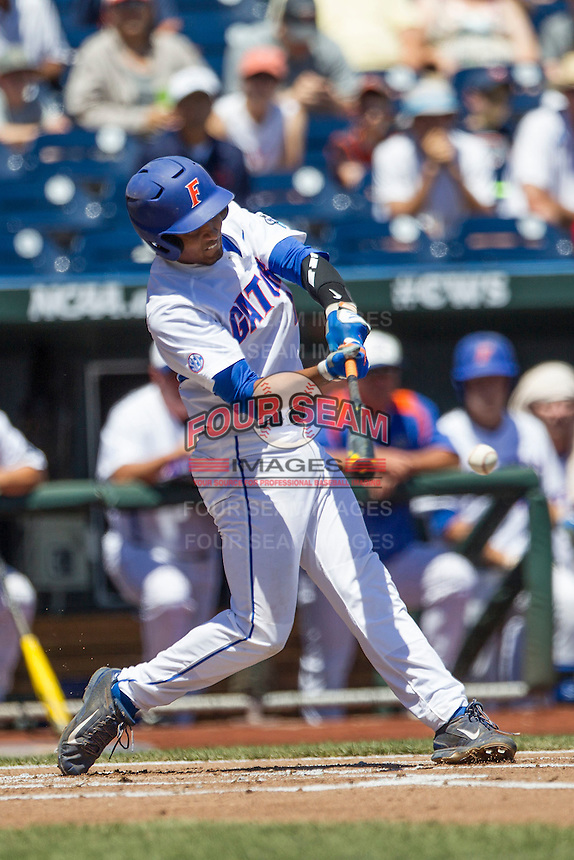 Florida Gators shortstop Richie Martin (12) swings the bat against the Virginia Cavaliers in Game 11 of the NCAA College World Series on June 19, 2015 at TD Ameritrade Park in Omaha, Nebraska. The Gators defeated Virginia 10-5. (Andrew Woolley/Four Seam Images)