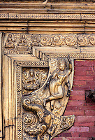 Nepal, Changu Narayan Temple, Western Entrance, before April 2015 earthquake.  The temple was heavily damaged in the earthquake, but will be repaired.  This shows the upper right portion of the  torana, the elaborate brass gateway to the temple.