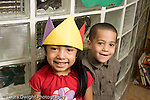 Education Preschool 3-5 year olds closeup portrait of two children girl wearing paper crown and boy horizontal