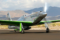 """A highly modified P-51D Mustang, owned by Ron Buccerelli and named """"Precious Metal,"""" taxies along the ramp at Stead Field in Nevada following the 2007 Reno Air Races. Modified for racing the standard Rolls Royce Merlin motor has been replaced by a Rolls Royce Griffon motor that includes contra rotating propellers as well as a smaller canopy.  Photographed 09/07"""