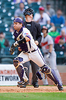 Texas Christian Horned Frogs catcher Kyle Bacak #6 chases after a foul pop fly as home plate umpire Jim Garman looks on during the game against the Sam Houston State Bearkats at Minute Maid Park on February 28, 2014 in Houston, Texas.  The Bearkats defeated the Horned Frogs 9-4.  (Brian Westerholt/Four Seam Images)