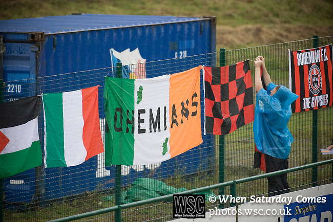The New Saints 4 Bohemians 0, 20/07/2010. Park Hall Stadium, Champions League 2nd qualifying round 2nd leg. A supporter of Irish club Bohemians tying flags behind the goal at Park Hall Stadium, Oswestry before their team's Champions League 2nd qualifying round 2nd leg game away to The New Saints. Despite leading 1-0 from the first leg, the Dublin club went out following their 4-0 defeat by the Welsh champions. The match was the first-ever Champions League match in the UK played on an artificial pitch and was staged at the Welsh Premier League's ground which was located over the border in England. Photo by Colin McPherson.