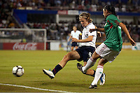 Heather O'Reilly of USA (L) during the semifinal match of CONCACAF Women's World Cup Qualifying tournament held at Estadio Quintana Roo in Cancun, Mexico. Mexico 2, USA 1.