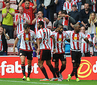 Jermain Defoe (2nd from right) of Sunderland celebrates scoring their first goal with team mates during the Barclays Premier League match between Sunderland and Swansea City played at Stadium of Light, Sunderland