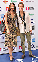 Kristina Hawkes and Chesney Hawkes at the Nordoff Robbins O2 Silver Clef Awards 2019, JW Marriott Grosvenor House Hotel, Park Lane, London, England, UK, on Friday 05th July 2019.<br /> CAP/CAN<br /> ©CAN/Capital Pictures