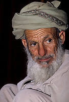Muscat, Oman.  Old Man Wearing Traditional Omani Msarr.