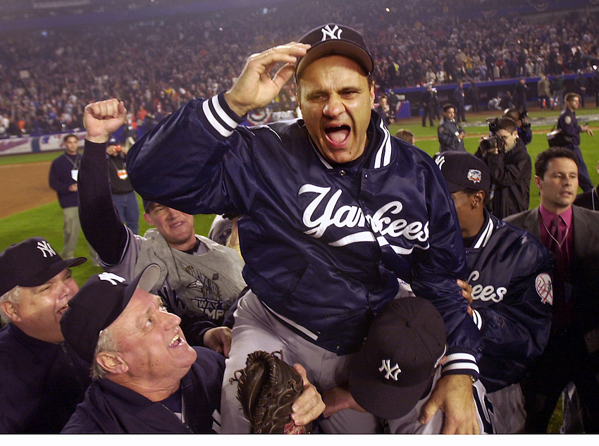 NEW YORK --Yankees manager Joe Torre is carried off the field on his players shoulders as the Yanks win Game 5 of the World Series between the Yankees and the Mets at Shea Stadium in Queens. (10/26/2000) ANDREW MILLS/THE-STAR LEDGER