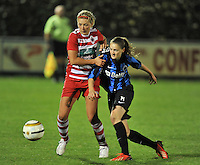 20131001 - VARSENARE , BELGIUM :  Antwerp Sophie Mannaert (left) pictured with Brugge's Bieke Vandenbussche during the female soccer match between Club Brugge Vrouwen and Royal Antwerp FC Ladies , of the fifth matchday in the BENELEAGUE competition. Tuesday 1 October 2013. PHOTO DAVID CATRY