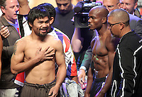 Boxers Manny Pacquiao,L, and Timothy Bradley ,R, pose during the weigh-in Friday June 8, 2012, for their bout at the MGM Grand Hotel/Casino in Las Vegas, Nevada. Pacquiao weighed-in at 147 lbs. Bradley weighed- in at 146 lbs. Pacquiao will defend his WBO welterweight title against Bradley when the two meet in the ring on June 9 at the MGM Grand Garden Arena in Las Vegas.  Photo John Gurzinski