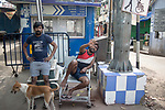 Two men loiter in the open during a total lockdown in India due to stop Corona Virus from spreading in communities. Kolkata, West Bengal, India. Arindam Mukherjee