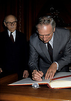 FILE PHOTO -  L'acteur Yves Montant signe le livre d'Or de la Ville de Montreal sous l'oeil du Maire Jean Drapeau <br /> le 1er  Octobre 1986<br /> <br /> PHOTO :   Agence quebec Presse