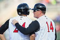Kannapolis Intimidators manager Pete Rose Jr. (14) talks to Jacob Morris (24) during the game against the Hickory Crawdads at CMC-Northeast Stadium on May 18, 2014 in Kannapolis, North Carolina.  The Intimidators defeated the Crawdads 6-5 in 10 innings.  (Brian Westerholt/Four Seam Images)