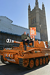 Pictured:  James Haskell and Paul Olima stand ontop of the Grenade® tank outside the Houses of Parliament in protest of #KeepingGymsOpen during the second Coronavirus lockdown that starts tomorrow in England.<br /> <br /> A bright orange tank driven by England rugby star James Haskell headed to Parliament Square today and caused a ruckus as it was stopped by police.  The former international was joining performance nutrition brand Grenade in protesting gyms and leisure centres being classified as 'non-essential' under new lockdown regulations.<br /> <br /> There were a reported 22 million visits to gyms after they reopened in July, with just 78 Covid cases being tracked to these locations.  With England set to return to a nationwide lockdown from tomorrow (Thursday November 4) these leisure facilities will once again be forced to close, not being classed as 'essential'. SEE OUR COPY FOR DETAILS<br /> <br /> © Solent News & Photo Agency<br /> UK +44 (0) 2380 458800