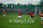 Duaghs Ciaran Lucey been hooked by Ballyheigue's Damien Casey in the final of the 2020 Junior hurling championship.