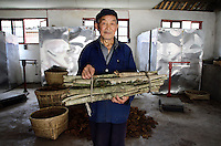 A local farmer brings tree bark, used for traditional Chinese medicine (TCM), into the EU-China Biodiversity Program-sponsored center that aims to control and monitor the amount of TCM harvested from the local forests. Pingwu County in Sichuan Province, south-west China.