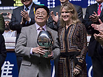 David Hui Cheung Wing (L), owner of the horse Travel Comforts receives the prize after winning the Two Challenge Trophy (Handicap)  on 29 March 2017, at Happy Valley Racecourse  in Hong Kong, China. Photo by Chris Wong / Power Sport Images