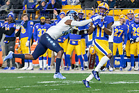 Pitt wide receiver Taysir Mack (11) makes a catch despite the efforts of North Carolina defensive back DeAndre Hollins (15). The Pitt Panthers defeated the North Carolina Tarheels 34-27 in overtime in the football game on November 14, 2019 at Heinz Field, Pittsburgh, Pennsylvania.