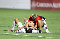 CARY, NC - AUGUST 01: Alex Crognale #21 is checked by trainer Maggi Campanaro during a game between Birmingham Legion FC and North Carolina FC at Sahlen's Stadium at WakeMed Soccer Park on August 01, 2020 in Cary, North Carolina.