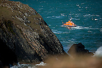 "Friday  29 April 2016<br /> Pictured:  A lifeboat searches along the coast<br /> <br /> Re: Two fishermen who went missing after a boat sank in Pembrokeshire went overboard while lobster pots were being thrown into the sea.<br /> Gareth Willington, 59, from Carew, died after his boat The Harvester sank off St David's Head on 28 April.<br /> The body of his son, Daniel, 32, has never been found.<br /> Gareth Willington was not wearing a lifejacket when he was found, a report by the Marine Accident Investigation Branch said.<br /> The investigation found the pair were lobster fishing near Ramsay Island when Daniel Willington may have become entangled in ropes on the deck.<br /> His father may have tried to help him before both men went into the water ""in quick succession"", it said."