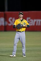 AZL Athletics right fielder Mickey McDonald (6) warms up in the outfield between innings of a game against the AZL Angels on July 22, 2017 at Tempe Diablo Stadium in Tempe, Arizona. AZL Athletics defeated the AZL Angels 5-4. (Zachary Lucy/Four Seam Images)