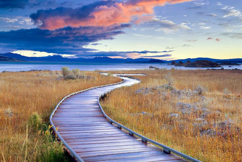 Borad pathway to Mono Lake with sunrise clouds. California