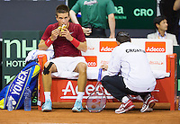 September 12, 2014, Netherlands, Amsterdam, Ziggo Dome, Davis Cup Netherlands-Croatia, Borna Coric (CRO) on the bench with his captain<br /> Photo: Tennisimages/Henk Koster