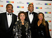 From left to right: Calvin Hill, wife Janet, Grant Hill and wife Tamia, arrive for the formal Artist's Dinner honoring the recipients of the 40th Annual Kennedy Center Honors hosted by United States Secretary of State Rex Tillerson at the US Department of State in Washington, D.C. on Saturday, December 2, 2017. The 2017 honorees are: American dancer and choreographer Carmen de Lavallade; Cuban American singer-songwriter and actress Gloria Estefan; American hip hop artist and entertainment icon LL COOL J; American television writer and producer Norman Lear; and American musician and record producer Lionel Richie.  <br /> Credit: Ron Sachs / Pool via CNP