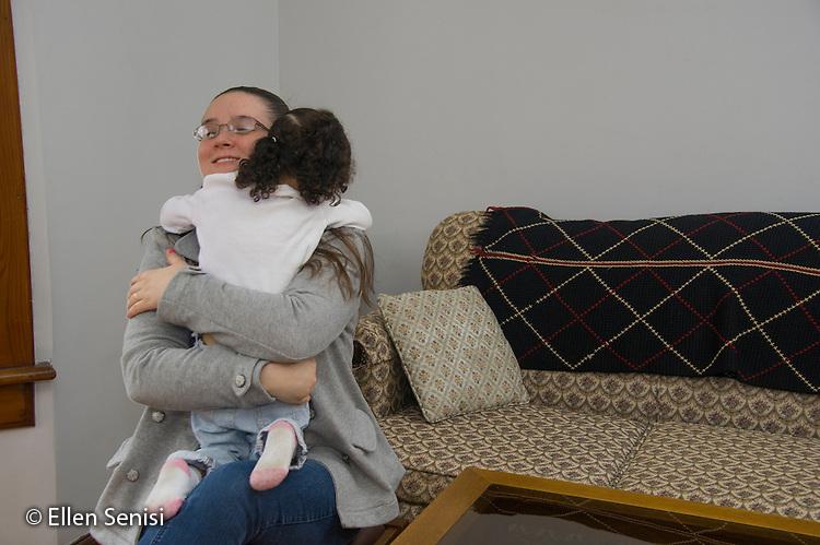 MR / Schenectady, NY. Mother hugs her pre-school aged daughter (girl, 3, African American and Caucasian). MR: Dal5, Dal6. ID: AM-HD. © Ellen B. Senisi
