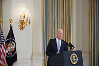U.S. President Joe Biden speaks in the State Dining Room of the White House in Washington, D.C., U.S., on Friday, Sept. 24, 2021. The U.S. will begin giving Covid-19 booster shots to millions of Americans today, a watershed moment in the nation's battle against the pandemic that officials hope will beat back another brutal winter wave of infections. <br /> Credit: Al Drago / Pool via CNP /MediaPunch