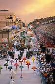 Rio de Janeiro, Brazil. Carnival; dawn in  the Sambadrome with girls in feather costumes and floats; Beija Flor samba school.