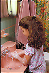 young girl washing hands, obsessive compulsive disorder