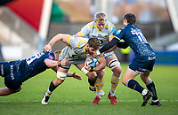 27th December 2020; AJ Bell Stadium, Salford, Lancashire, England; English Premiership Rugby, Sale Sharks versus Wasps;  Thomas Young (c) of Wasps  is tackled by  Matt Postlethwaite and  AJ MacGinty of Sale Sharks