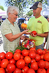 Linda Marrone talks with Matt Minton, of Minton's Farm Fresh Produce, of Yuba City, Ca., at the 3rd & Curry St. Farmers Market in downtown Carson City, Nev. on Sept. 11, 2010..Photo by Cathleen Allison/NevadaPhotoSource.com