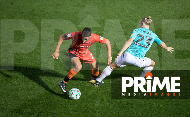 Nick Freeman of Wycombe Wanderers turns Joseph Mills of Forest Green Rovers during the Carabao Cup 2nd round match between Wycombe Wanderers and Forest Green Rovers at Adams Park, High Wycombe, England on 28 August 2018. Photo by Andy Rowland.