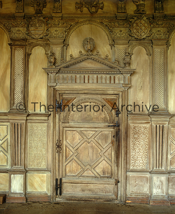 The elaborately carved wooden doorway leading from the Long Gallery to the Anteroom of the State Bedroom at Haddon Hall