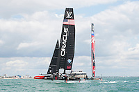 25 July 2015: Oracle Team USA ahead of Emirates Team New Zealand during the America's Cup first round racing off Portsmouth, England (Photo by Rob Munro)