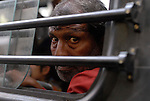 Man on a bus in New Delhi, India.