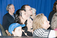 Husband Chasten Buttigieg watches Democratic presidential candidate and former South Bend, Ind., mayor Pete Buttigieg speak at his Primary Night rally at Nashua Community College in Nashua, New Hampshire, on Tue., Feb. 11, 2020. Democratic presidential candidate and Vermont senator Bernie Sanders was projected to win the New Hampshire Democratic Primary, but Buttigieg came in a close second.