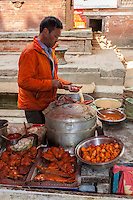 Nepal, Patan.  Street Food Vendor Preparing Food.
