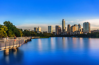 Runners, joggers and bikers take an early morning stroll on the the Boardwalk Trail on Lady Bird Lake overlooking the majestic and every booming Austin Skyline. <br /> <br /> In the heart of Austin is the Ann and Roy Butler Hike-and-Bike Trail at Lady Bird Lake, a lush, urban path that meanders along the water's edge and passes by skyscrapers, neighborhoods, ball fields and cultural attractions. With the completion of the Boardwalk portion of the Trail in June 2014, the 1.3 mile gap along the south shore has been closed, and the Trail now serves our city in an additional way – as an alternative transportation route for our growing urban core.